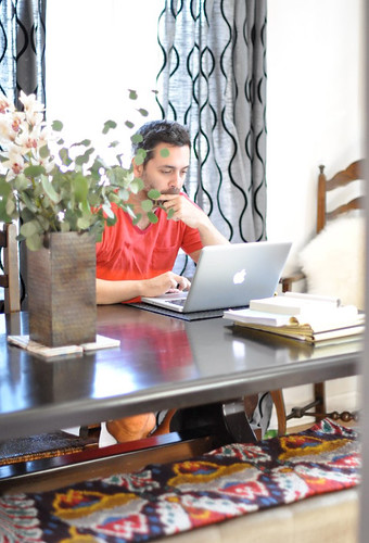 husband, working, at the dining room table