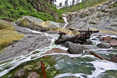 Hyperacidic Stream (tropicaLiving - Jessy Eykendorp) Tags: green nature canon river indonesia landscape photography eos volcano waterfall nationalpark rocks stream natural outdoor smoke acid mining mount crater nd sulphur sulfur filters rim acidic 1022mm miner surabaya bromo semeru tengger canonefs1022mmf3545usm vari asam eastjava pollutant 50d ijen kawah banyuwangi canon50d bondowoso belerang signhray