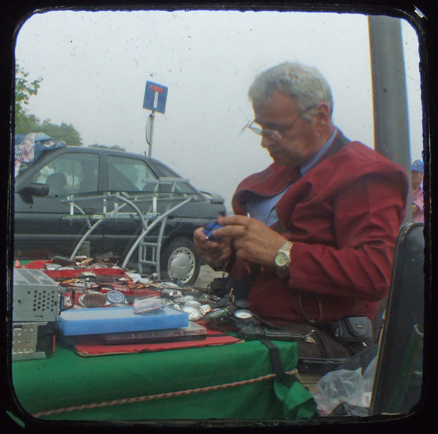 Watch repairer at the flea market