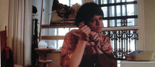 Bobby Deerfield, 1977. Phone, half-finished weaving, pout.