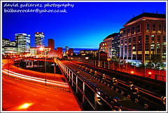 London Docklands, Twilight Railway at Night (david gutierrez [ www.davidgutierrez.co.uk ]) Tags: city blue sky urban building london colors architecture night buildings dark spectacular geotagged photography photo twilight arquitectura cityscape darkness image dusk sony centre cities cityscapes railway center structure architectural nighttime 350 hour londres architektur nights docklands sensational metropolis bluehour alpha londra dlr impressive dt londoncity nightfall municipality edifice londonnight cites londondocklands f4556 1118mm londonphotography sonyalphadt1118mmf4556 sony350dslra350 londonbluehour