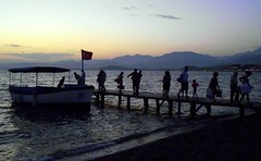 Sovalye Island ferry (* RICHARD M) Tags: travel sea mountains water night turkey boats sailing jetty transport silhouettes sunsets flags maritime beaches nautical ferries scapes calis ferryboats mugla fethiyebay sovalyeisland
