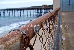 Catherine Hill Bay Coal Jetty (Life with Jordy) Tags: beach rust raw decay jetty australia mining wharf newsouthwales coal jordy photoshopelements burntool catherinehillbay panasonicdmcfz30 petejordan lifewithjordy
