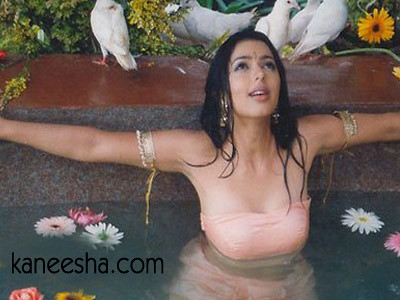 Bhumika Chawla in a pond with sunflowers and other flowers