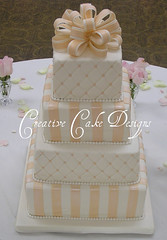 Square Wedding cake (Christina's Dessertery) Tags: wedding cake square four pastel stripes weddingcake peach ivory bow quilting loopy tier fondant gumpaste dragees pearlborder jenniferdontz creativecakedesigns