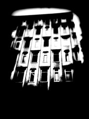 Highdontknowwhattocallit (catcalledmorris) Tags: street city windows england blackandwhite white abstract black blur building art window buildings manchester shadows bricks grain piccadilly citycentre 2010 iphone
