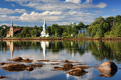 Early Morning at Mahone Bay (sminky_pinky100 (In and Out)) Tags: travel trees canada tourism water clouds reflections landscape rocks pretty novascotia gulls earlymorning churches scene picturesque southshore mahonebay threesisiters abigfave omot cans2s earlymroning