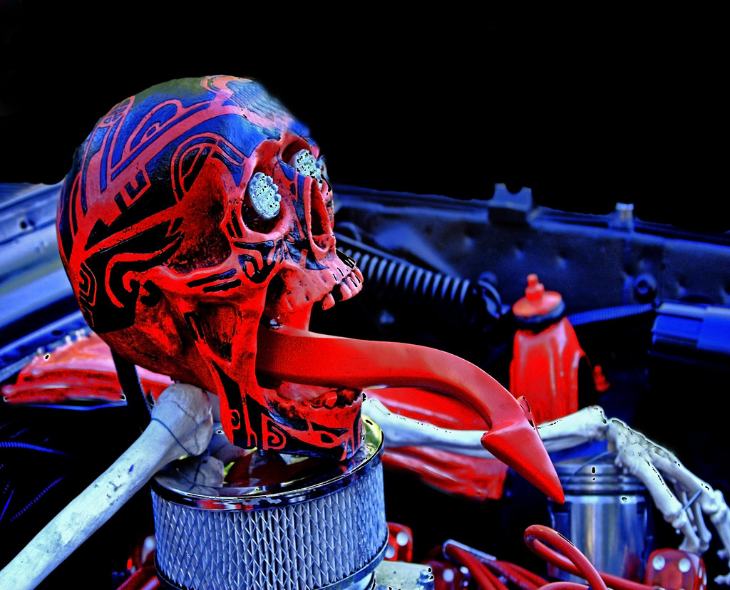 red and black customized skeleton head on car air filter