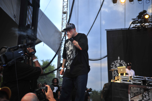 B-Real takes a hit on stage at Lollapalooza