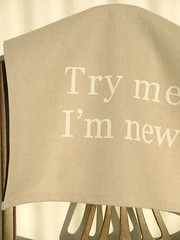 Try Me, I'm New (wild roses grow) Tags: typography funny handmade linen dishcloth cloth printed quirky offbeat teatowel wording handpulled fabricprinting screenprinted fabricink cottontwilltape