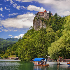 Slovenia - Lake Bled - Bled Castle sq v2 (Darrell Godliman) Tags: travel copyright cliff lake mountains travelling tourism landscape boat nikon europe view squares eu landmark slovenia squareformat vista bled slovenija viewpoint sq europeanunion allrightsreserved lakebled travelphotography julianalps europeseunie slovenien bsquare unineuropea instantfave unioneuropenne republikaslovenija omot travelphotographer flickrelite dgphotos darrellgodliman wwwdgphotoscouk scenicsnotjustlandscapes d300s dgodliman nikond300s exposition5 slovenialakebledbledcastlesqv2dsc2337