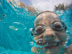 Bubbles (guerilladogs) Tags: blue summer water pool girl smile swimming fun underwater corsica goggles bubbles hd gopro