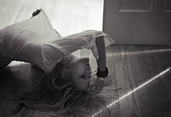 (galaxies and hurricanes) Tags: door wood bon light portrait woman white black girl face shirt digital self hair photography back eyes closed long jen sad floor arm emotion skin body jennifer jaw grain hard down lips blonde bracelet flannel streaks shoulder beams upside iver arched janowsky