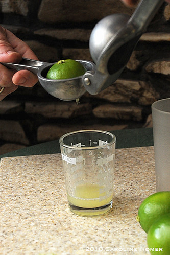 Step three: squeeze the lime juice into the measuring glass.
