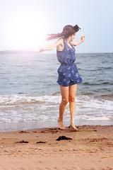 Sunkissed (leasqueaky) Tags: city sun sunlight newyork beach water brooklyn canon lens rebel 50mm dance sand ballerina kiss dancing bright flare statenisland 18 sunbeam sunkissed xsi sunkiss