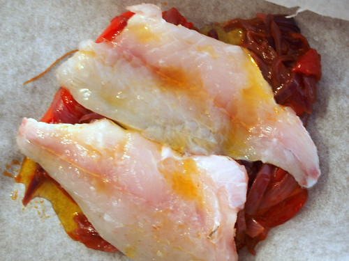 Dorade fillets on peperonata wrapped in baking paper