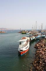 Eilat, Israel (seduffel) Tags: red sea beach water boats israel rocks redsea ships shoreline jordan shore mast eilat