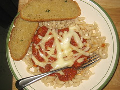 Bowl of pasta with homemade sauce and homemade bread