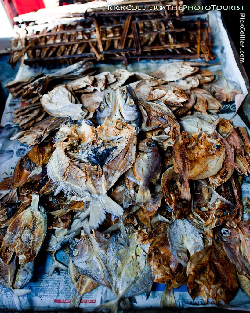 A pile of dried and cooked fish on a newspaper-covered table, in the Aertembaga Market, Bitung, North Sulawesi, Indonesia