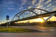 Train bridge (bobbrink) Tags: bridge sunset sky sun train canon zonsondergang 300d railway tokina groningen zon hdr 1224 fietspad spoorbrug photomatix walfridusbrug walfridus