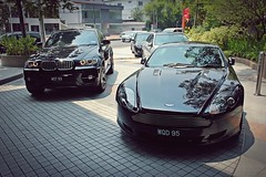 Angel rings Black-on-Black (///r3) Tags: black cars sports martin exotic bmw coupe supercar v8 automobiles aston beemer db9 x6 transaxle worldcars wqd95 wst93