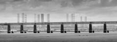 Tay Rail Bridge and rigs (M2258862 8x1x3 E-M1ii 300mm iso200 f5.6 1_800s) (Mel Stephens) Tags: mzuiko pro 300mm 43 fourthirds mmf3 zuiko 918mm ptgui stitched panorama panoramic bw black white silver efex widescreen structure tay railway rail bridge transport oil rigs coast coastal river firth tayside wormit scotland uk dundee 20170625 201706 2017 q2 olympus omd em1ii ii m43 microfourthirds mirrorless longweekendcatsittingindundee best june