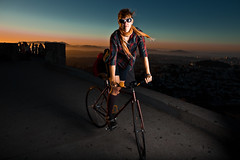 Romantic cycling sunset (reelgeek) Tags: sanfrancisco lighting city sunset portrait sky urban bike cycling dusk sally twinpeaks locationshots strobist reelgeekfp