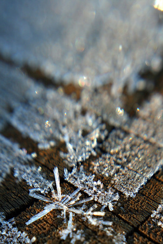 Frost on a wood post.