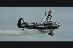 minnesota air show (Dan Anderson (dead camera, RIP)) Tags: minnesota airplane flying crazy airshow entertainment flyingcircus mn daredevil stunt jollyroger wingwalking aerobatics stcloud stuntplane gmas wingwalker biwing kylefranklin airwalkers amandafranklin captainkyro franklinsflyingcircus piratedskies scandalousscarlett greatminnesotaairshow franklinsairshow thepiratedskies