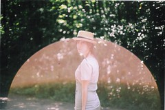 (b r e e) Tags: light sun film hat fashion forest canon 50mm bokeh nathalie flare canonae1 leak sunflare sooc