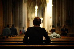 Prayer, New York, New York (Seven Seconds Before Sunrise) Tags: nyc newyorkcity people woman newyork church 50mm unitedstates manhattan pray stpatrickscathedral pew
