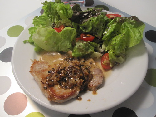 Pork chop with cream and onion sauce, salad