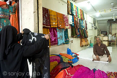 The shopkeeper, Hyderabad, India (sanjayausta) Tags: street old people india shop asian photography asia photographer shots indian south muslim hijab documentary exotic muslims hyderabad niqab ethnic andhra sanjay burqa pradesh keeper austa hyderabadi populations
