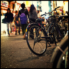 Bicycle in the night, Shimo-Kita (Eric Flexyourhead) Tags: street city people urban motion blur bike bicycle japan night walking japanese lights tokyo evening movement 11 66   setagaya shimokitazawa   setagayaku sigmaaf30mmf14exdchsm olympuse3