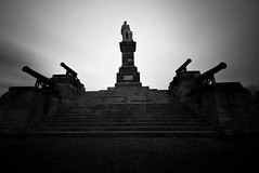 Collingwood  Monument (GeordieCraig) Tags: uk light sea sky blackandwhite beach monument monochrome lines statue architecture clouds buildings coast long exposure moody collingwood low landmarks sigma wideangle neutraldensity nd110