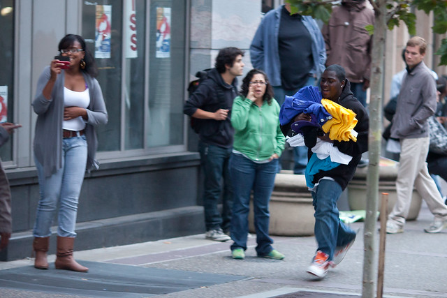 Looter Runs Down Broadway With Items Taken From Foot Locker, Oakland Riots, 2010