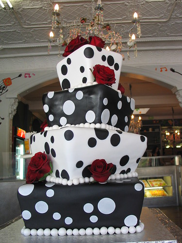 4 tier Square Mad hatter wedding cake black and white polka dot cake with red roses
