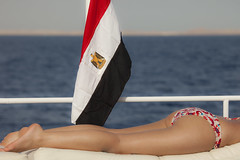 Sharm El Sheikh is a bikiniland (Maine Surfer) Tags: blue trees red sea vacation sky sun beach water girl clouds boat wind bokeh yacht flag leg egypt sharmelsheikh el tourist palm spanish bikini russian sheikh hurgada sinai shar  colorphotoaward egypet sharelsheikh