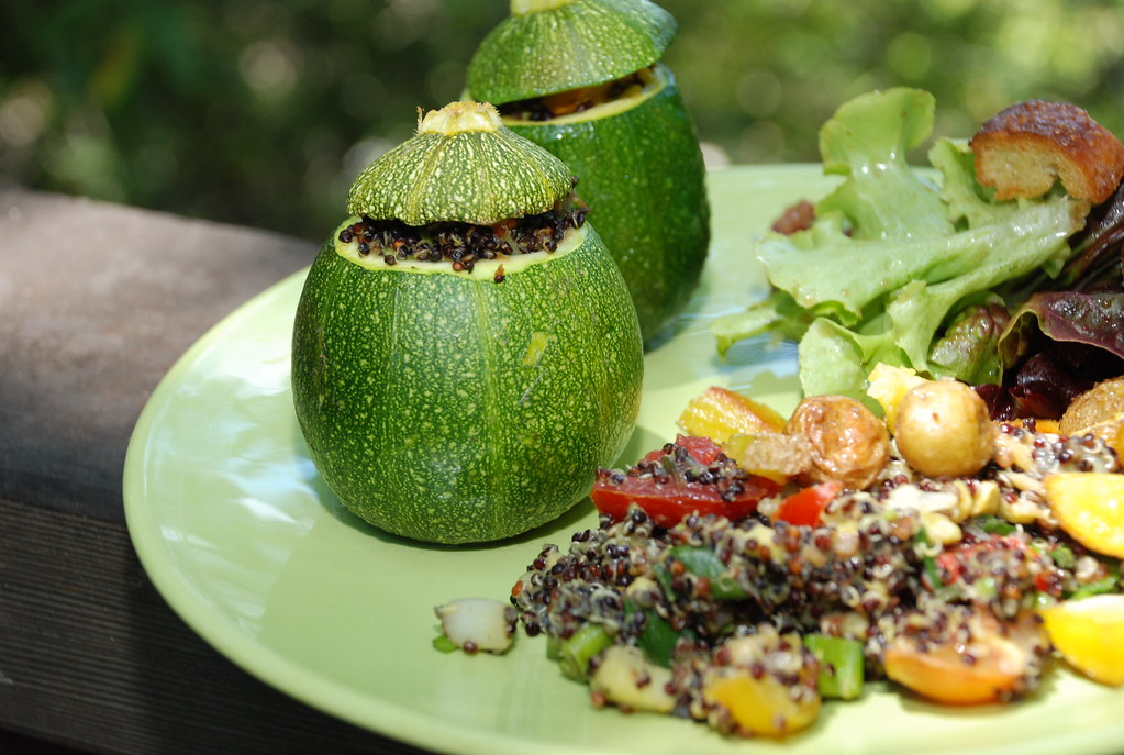 stuffed squash with salad and potatoes and breadcrumbs