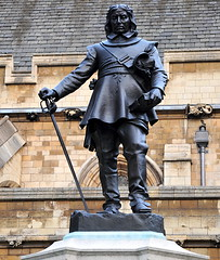 Oliver Cromwell () Tags: street camera uk greatbritain vacation england holiday man london westminster statue wall calle nikon downtown britishisles unitedkingdom britain centro thecity streetphotography housesofparliament parliament corso streetscene brickwall londres sword gb leader bronzestatue 70300mm londra whitehall vacanze lhr houseofparliament thecommons houseoflords londinium palaceofwestminster houseofcommons westminsterhall globetrotter centrallondon olivercromwell governmentbuilding  bronzesculpture londonist lordprotector westminsterpalace 1658 englishparliament streetsoflondon cityofwestminster  1599 thelords  politicalleader worldtraveler ad43 22days constitutionalmonarchy militaryleader thehouseoflords d700  nikond700 republicancommonwealth palaceofwestminsterwestminsterhall houseofpeers thelordsspiritualandtemporal