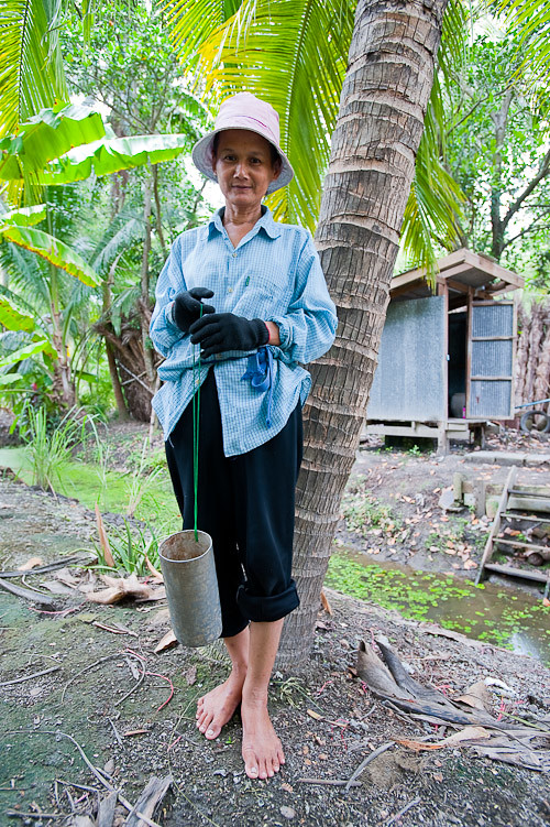 A sugar palm sap gatherer, Samut Songkhram, Thailand