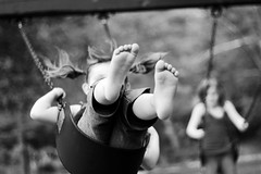 Up. (Rebecca Tabor Armstrong) Tags: summer portrait bw playground movement dof swing swingset pigtails lakearrowhead 50mmf18