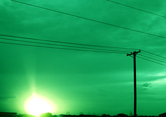 Green Sky (youngfreelost) Tags: light sunset sky cloud sun green electric glare bright telephone orb line cables flare powerline electrical brood cableicious