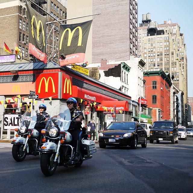 Police escort in front of the McDonalds #walkingtoworktoday