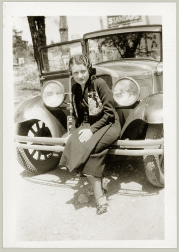 Girl sitting on a bumper