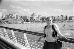 At the Pier (5) (emiel_dk) Tags: beach pier scheveningen denhaag lara neopan 40mm kurhaus thehague youngwoman yellowfilter fujineopan400 rollei35se sonnar40f28 sonnarf28