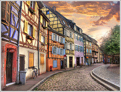 Colors from Colmar (Jean-Michel Priaux) Tags: street city windows house france art colors bicycle architecture photoshop painting landscape alley village path couleurs maisons colmar alsace ruelle paysage maison rue couleur anotherworld colombage priaux lepetitgourmand quaidelapoissonnerie vanagram magiayfotografia