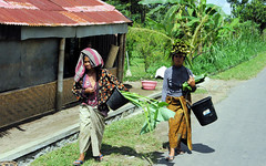 Women on The Road (cwgoodroe) Tags: road door summer bali sun beach statue rock forest indonesia island tin lava asia surf locals rice culture carving rusted limestone cockfight ubud kuta lifeguardstand seminyak moneky batubulan
