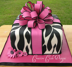 Explored: Aug. 14, 2010 #93 Present Cake gets a makeover!!! (Christina's Dessertery) Tags: birthday pink wedding baby white black cake daisies square shower strawberry cream 8 sugar fuschia fabric bow present loopy ribbon bouquet bridal simple fondant gumpaste christinajohnson zebrastripe creativecakedesigns