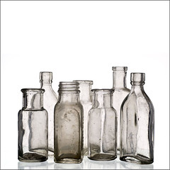 antique glass bottles (explored) (friendlydrag0n) Tags: old white glass vintage square bottles antique background ground dirty clear drug medicine isolated mixture fashioned explored